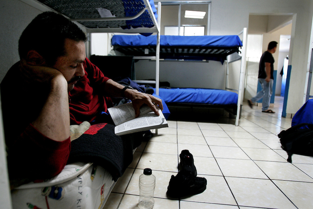 A recovering Heroin addict, who chose to remain anonymous, reads a book on his bunk at the Los Tesoros Escondidos Drug Rehabilitation Centerin Tijuana, Mexico.
