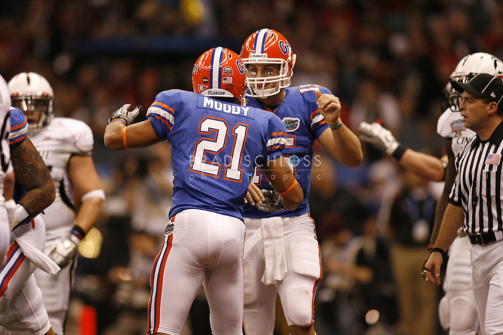 01 JAN 2010:  Florida quarterback Tim Tebow celebrates with running back Emmanuel Moody after a second half touchdown during the Gators 51-24 victory over the Cincinnati Bearcats in the 2010 Allstate Sugar Bowl at the Louisiana Superdome in New Orleans, LA.