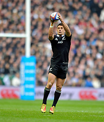 Dan Carter (New Zealand) receives a pass - Photo mandatory by-line: Patrick Khachfe/JMP - Tel: Mobile: 07966 386802 16/11/2013 - SPORT - RUGBY UNION -  Twickenham Stadium, London - England v New Zealand - QBE Autumn Internationals.