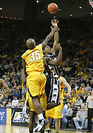 24 JANUARY 2007: Iowa guard Mike Henderson (35) tries to block a shot by Penn State guard/forward Geary Claxton (5) in Iowa's 79-63 win over Penn State at Carver-Hawkeye Arena in Iowa City, Iowa on January 24, 2007.