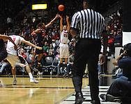 "Ole Miss' Marshall Henderson (22) shoots vs. Auburn guard Frankie Sullivan (23) at the C.M. ""Tad"" Smith Coliseum on Saturday, February 23, 2013.  (AP Photo/Oxford Eagle, Bruce Newman)"