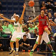 Skylar Diggins, Notre Dame, (left) and Bria Smith, Louisville, in action during the Notre Dame Fighting Irish V Louisville Cardinals Semi Final match during the Big East Conference, 2013 Women's Basketball Championships at the XL Center, Hartford, Connecticut, USA. 11th March. Photo Tim Clayton