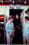 Jimmy and Rosslyn  Carter leave Billy Carter's general store in Plains Georgia in October 1979..Photograph by Dennis Brack BBBs 20
