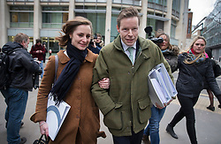 © Licensed to London News Pictures. 03/02/2016. London, UK. George Bingham leaves The High Court with his wife Anne-Sofie Foghsgaard after he was granted a death certificate for his father Lord Lucan.  The death certificate was issued 42 years after the peer went mssing after his children's nanny was murdered in London. After he was declared dead in 1999, today's new ruling gives his son the right to inherit the family title. Photo credit: Peter Macdiarmid/LNP