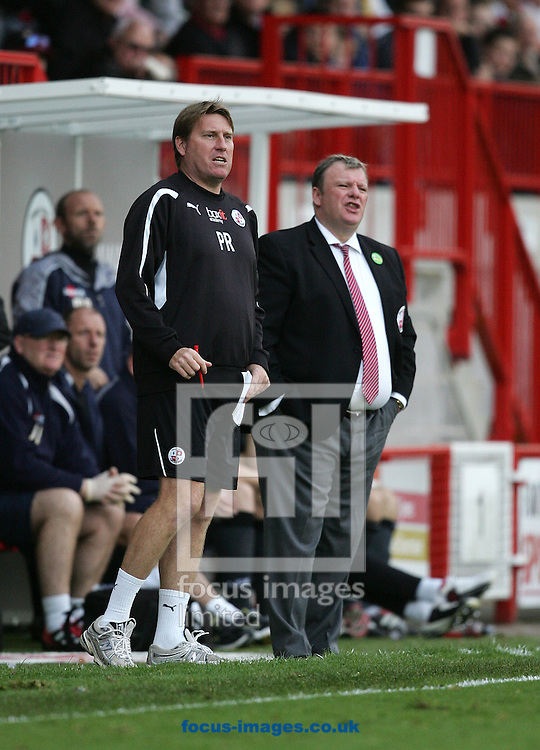 Picture by Paul Terry/Focus Images Ltd. 07545642257.29/10/11.Steve Evans (R), manager of Crawley with his assistant Paul Raynor  during the Npower League 2 match at the Broadwood stadium, Crawley, West Sussex.
