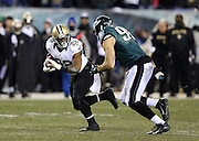 New Orleans Saints running back Mark Ingram (22) catches a second quarter pass good for a first down as he tries to elude a tackle attempt by Philadelphia Eagles outside linebacker Connor Barwin (98) during the NFL NFC Wild Card football game against the Philadelphia Eagles on Saturday, Jan. 4, 2014 in Philadelphia. The Saints won the game 26-24. ©Paul Anthony Spinelli