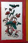 Detail from interior of a Chinese Temple in Port Louis. Lotus leaves and flowers.