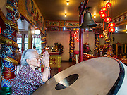 "09 FEBRUARY 2014 - HAT YAI, SONGKHLA, THAILAND: A woman prays in the Chao Mae Tubtim Shrine (Ruby Goddess Shrine) on 108 Hainanese Ancestors Memorial Day in Hat Yai, Songkhla, Thailand. Hainanese communities around the world celebrate ""108 Hainanese Ancestors Memorial Day."" The day honors the time when 109 Hainanese villagers fleeing life in Hainan (an island off of the southwest coast of China, near Vietnam) washed up in what is now Vietnam and were killed by Vietnamese authorities because authorities thought they were pirates. The Vietnamese built a temple on the site and named it ""Zhao Yin Ying Lie."" Many Vietnamese fisherman credit prayers at the temple to saving their lives during violent storms and now ""108 Hainanese Ancestors Memorial Day"" is celebrated in Hainanese communities around the world. Hat Yai, the economic center of southern Thailand has a large Hainanese population.    PHOTO BY JACK KURTZ"