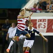 May 26 2012: USA's Fabian Johnson (23) leaps into the air to head the ball over Scotland's Matt Phillips (7) during the first half of play of the U.S. Men's National Soccer Team game against Scotland at Everbank Field in Jacksonville, FL. At halftime USA lead Scotland 2-1.