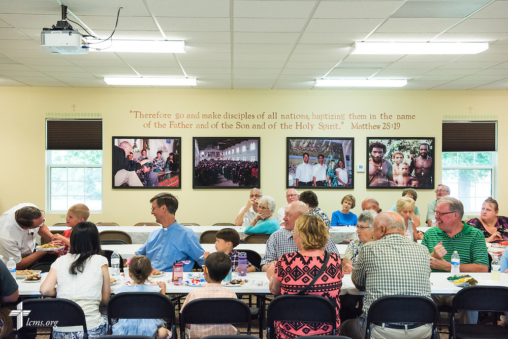 Gary Thies (far left, leaning over) leads fellowship time at Mission Central on Sunday, July 19, 2015, in Mapleton, Iowa. LCMS Communications/Erik M. Lunsford