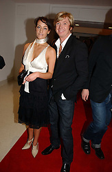 Hairdresser NICKY CLARKE and OCTAVIA COATE at a party to celebrate the 90th birthday of Vogue magazine held at The Serpentine Gallery, Kensington Gardens, London on 8th November 2006.<br />