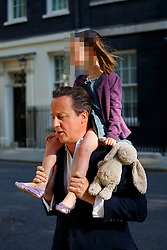 ***DAUGHTER'S FACE PIXELATED***© Licensed to London News Pictures. 01/07/2014. LONDON, UK. Prime Minister David Cameron leaves Downing Street and takes his daughter Florence to school before a cabinet meeting in Downing Street on Tuesday, 1 July 2014. Photo credit: Tolga Akmen/LNP