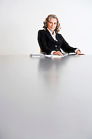 Female Business Executive Sitting by table