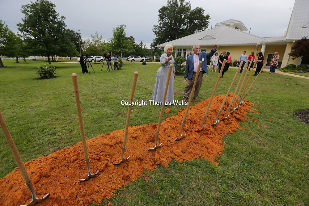 Heather Palmer, center, and Harold Plunkett discuss where to put everybody before the official groundbreaking for the expansion at the Santuary Hospice House in Tupelo on Monday.