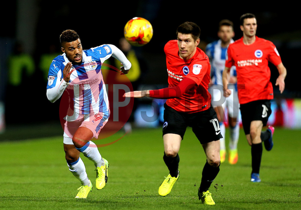 Elias Kachunga of Huddersfield Town and Sebastien Pocognoli of Brighton & Hove Albion chase the ball down - Mandatory by-line: Robbie Stephenson/JMP - 02/02/2017 - FOOTBALL - John Smith's Stadium - Huddersfield, England - Huddersfield Town v Brighton and Hove Albion - Sky Bet Championship