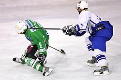 Ralph Intranuovo of Olimpija stopped by Jan Loboda of Medvescak at 3rd round of Slovenian Ice-Hockey National Championships semi-final match between HD Tilia Olimpija, Ljubljana and Medvescak Zagreb, Croatia, on March 11, 2009, in Hala Tivoli, Ljubljana, Slovenia. (Photo by Vid Ponikvar / Sportida)