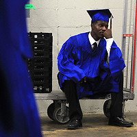 Anthony McGee sits on a drink cart killing time backstage before walking out with his classmates for the Tupelo High School graduation at the BancorpSouth Arena on Firday night.