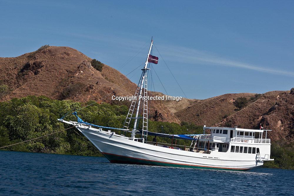 INDONESIA, Komodo island, on a traditional boat