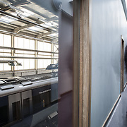 Building: Adelaide Maintenance Depot Architect: White Ink Architects Building Type: Industrial Town: Belfast County: Antrim Country: Northern Ireland Collection: Architecture The Adelaide Maintenance Depot is a purpose built facility on a brownfield site, that serves Tranlink's new fleet of trains that will be delivered in 2012. The site is a 24hr facility that will provide stabling for trains, re-fuelling and train wash facilities along with a Maintenance and Cleaning Shed and associated offices and storage. The design concept was to create a hierarchy of buildings across the site, with the Depot being the main building and all other buildings would use the same palette of materials to create a cohesive identity for the site facilities. The Depot is over 200m long and is a slick linear box clad in silver metallic cladding. The interior is bathed in diffuse daylight through translucent Kalwall cladding. The associated Accommodation Block is articulated at first floor as a projecting, floating box in distinctive red cladding. It projects at high level beyond the main shed, its dynamic form referencing the trains within. The buildings base is detailed in simple blue grey brick, that is used throughout the rest of the site for ancillary buildings. Careful detailing and co-ordination of services has ensured that the box forms are uncluttered and bold. The project is due for completion in October 2012.<br />