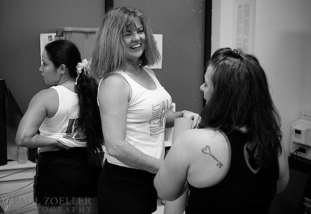 "LaDona Sutherland, middle, said, ""You will not see a bigger diverse group of women who get along so well."" Sutherland and others in the advanced pole dance class visit after advanced pole dance class at Goddess Dance Studio in Summerville."