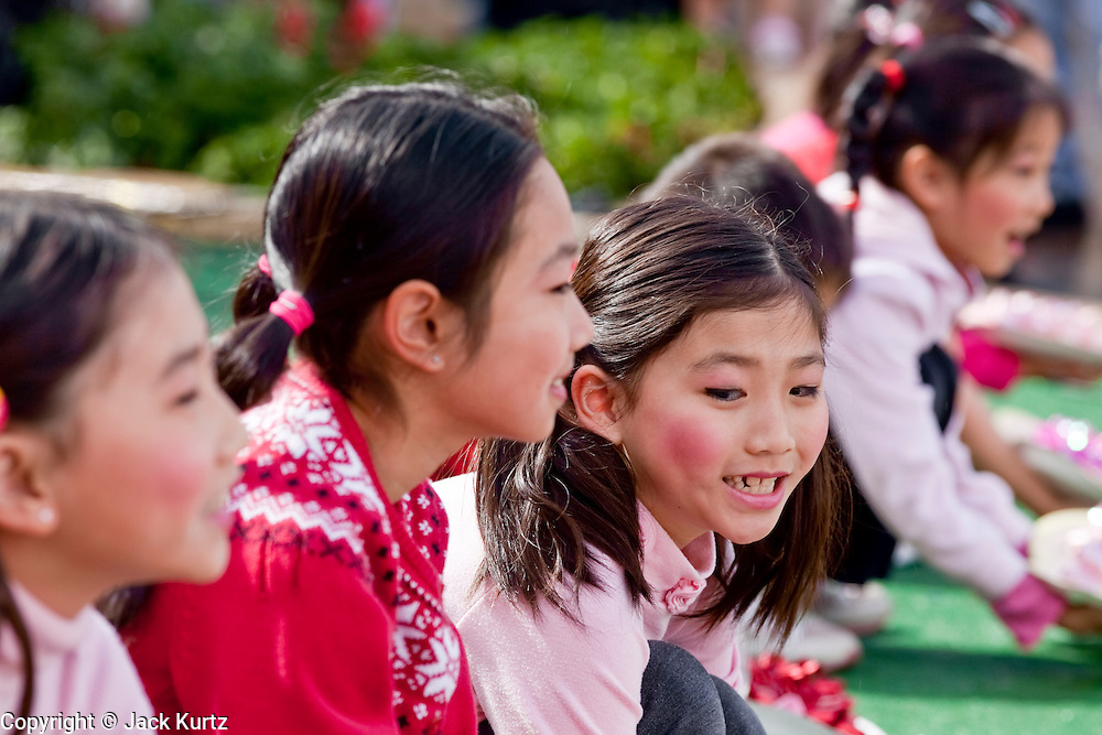 Feb. 8, 2009 -- PHOENIX, AZ: Students from the Arizona Hope Chinese School perform the Spring Flower dance at the Chinese Cultural Center in Phoenix, AZ. Chinese around the world celebrated the New Year this month. This is the Year of the Ox in the Chinese calender.  PHOTO BY JACK KURTZ