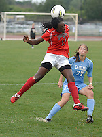 Ohio State forward Tiffany Cameron (11) flicks on a throw-in as OSU takes on University of North Carolina in the first half of an NCAA women's college soccer game in Columbus, Ohio on Sunday, Sept. 4, 2011, at Jesse Owens Memorial Stadium.