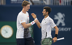 TORONTO, Aug. 7, 2018  Novak Djokovic (R) of Serbia and Kevin Anderson of South Africa celebrate victory after the frist round of men's doubles match against Denis ShapovalovFelix Auger-Aliassime of Canada at the 2018 Rogers Cup in Toronto, Canada, Aug. 6, 2018. Novak Djokovic and Kevin Anderson won 2-0. (Credit Image: © Xinhua via ZUMA Wire)