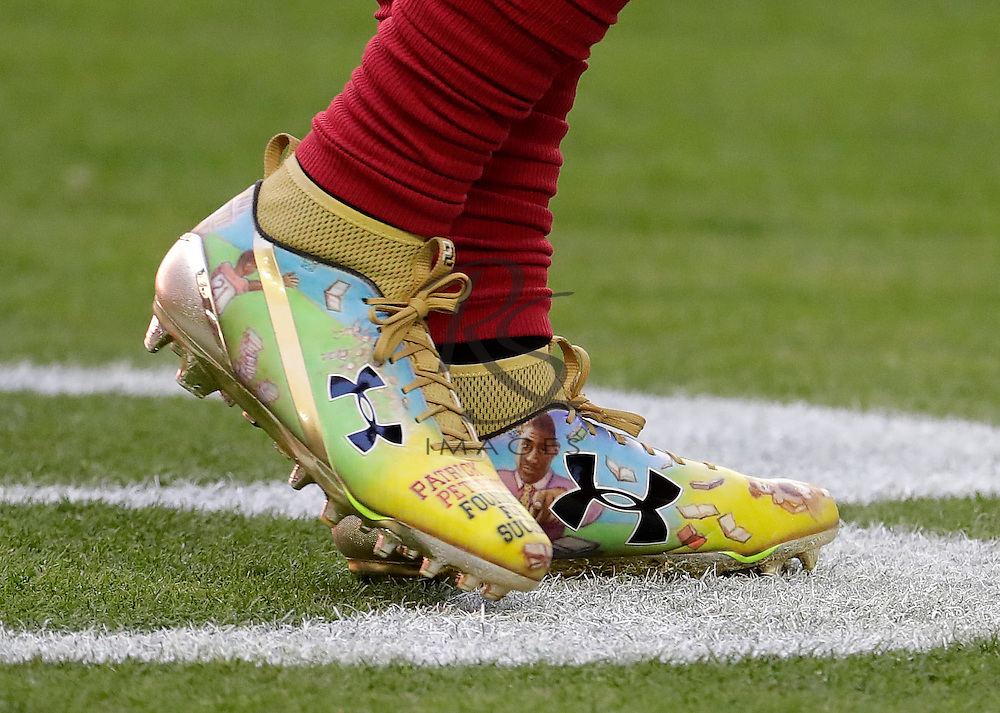Arizona Cardinals cornerback Patrick Peterson wears literacy issues cleats prior to an NFL football game against the Washington Redskins, Sunday, Dec. 4, 2016, in Glendale, Ariz. (AP Photo/Rick Scuteri)