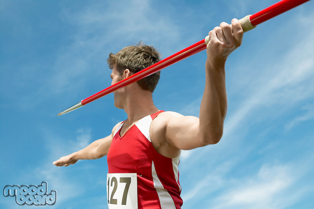Athlete about to throw javelin half length