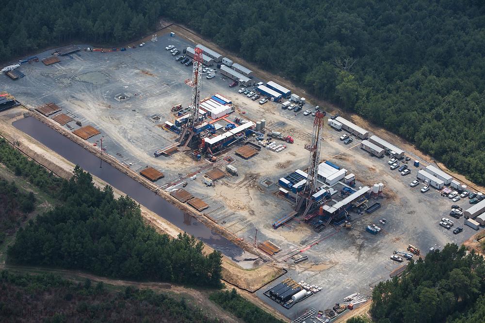 Two rigs on one fracksite near Westdale, Louisiana in Haynesville Shale region.