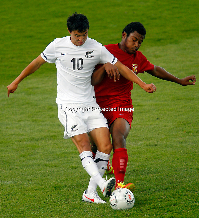 NZ's Sean Lovemore goes at it with PNG's Kila Polena. OFC Men's Olympic Qualifier New Zealand 2012, New Zealand v Papua New Guinea, Owen Delany Park Taupo, Friday 16th March 2012. Photo: Shane Wenzlick