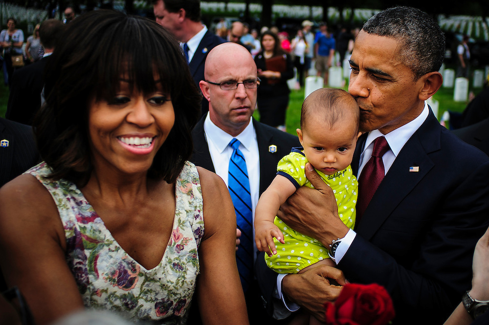 First Lady Michelle Obama and President Barack Obama greet mourners during a Memorial Day visit to Arlington National Cemetery in Arlington Virginia, USA on 27 May, 2013.
