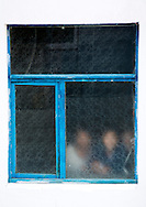 Workers behind a window at the Hungnam fertilizer complex in Hamhung, North Korea.