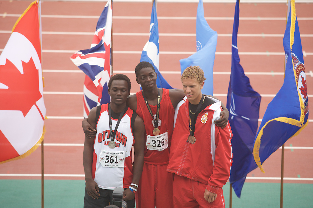 (Sherbrooke, Quebec -- 9 Aug 2009) \Brian Okeny\ competes in youth boys triple jump medal ceremony at the 2009 Legion Youth National Track and Field Championships. Photograph copyright Sean Burges / Mundo Sport Images  2009.