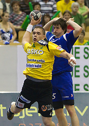 Vid Poteko of Celje and Sebastjan Krizman of Trimo during handball match between RK Celje Pivovarna Lasko and Trimo Trebnje of last Round of 1st Slovenian Handball league, on May 27, 2011 in Arena Zlatorog, Celje, Slovenia. Celje defeated Trimo 32-28 and win 3rd place in Slovenian National Championship. (Photo By Vid Ponikvar / Sportida.com)
