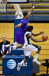 December 29, 2009; Berkeley, CA, USA;  Furman Paladins guard Darryl Evans (5) fouls Utah Valley Wolverines guard Corey Claitt (2) on a shot during the first half at the Haas Pavilion.  Furman defeated Utah Valley 77-69.
