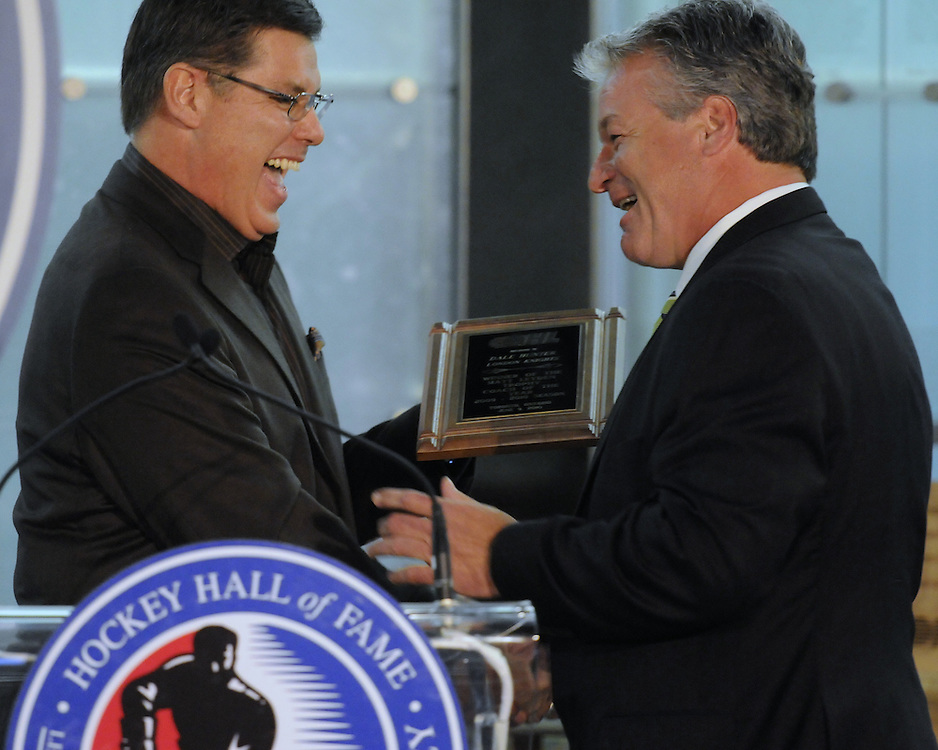 Rob Faulds (left) of Rogers Sportsnet and Dale Hunter of the London Knights share a laugh at the 2009-10 Ontario Hockey League Awards Ceremony at the Hockey Hall of Fame on Wednesday June 9, 2010. Photo by Aaron Bell/OHL Images
