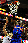 Feb. 25, 2011; Cleveland, OH, USA; New York Knicks power forward Amare Stoudemire (1) shoots over Cleveland Cavaliers shooting guard Anthony Parker (18) during the second quarter at Quicken Loans Arena. Mandatory Credit: Jason Miller-US PRESSWIRE