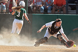 09 May 2014:  Sara Rogers scores ahead of a throw, Maddie Dieleman catches the incoming throwduring an NCAA Division III women's softball championship series game between the Lake Forest Foresters and the Illinois Wesleyan Titans in Bloomington IL