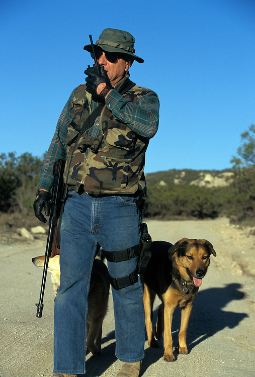 Vigilantes patrol the U.S.-Mexico border in San Diego, California in hopes of stopping the undocumented migrants from crossing their property into the United States. Please contact Todd Bigelow directly with your licensing requests.