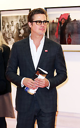 Image licensed to i-Images Picture Agency. 12/06/2014. Brad Pitt tours an art exhibition  on day three of the End Sexual Violence in Conflict  Global Summit in London.  Picture by Stephen Lock / i-Images