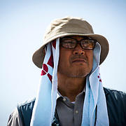 OKINAWA, JAPAN - JUNE 17 : Anti US airbase relocation leader Hiroji Yamashiro listen to speech of his fellow protesters during a demonstration in front of the Camp Schwab on June 17, 2016 in Nago, Okinawa, Japan. Protests to the new U.S Marine Air base on the northern part of the island of Okinawa have grown more intense in recent weeks due to the past incident of rape and drunk driving over American Military Presence in Japan. Photo: Richard Atrero de Guzman