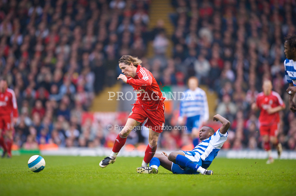 LIVERPOOL, ENGLAND - Saturday, March 15, 2008: Liverpool's Fernando Torres and Reading's Kalifa Cisse in action during the Premiership match at Anfield. (Photo by David Rawcliffe/Propaganda)
