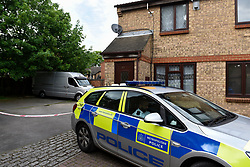© Licensed to London News Pictures. 14/05/2018. LONDON, UK.  A police car is stationed outside a cordoned-off property in Hayes, in west London.  It is reported that a 51 year old man handed himself into a north London police station confessing to harming a woman at a Hayes address.  Officers who visited the address in Gade Close found a deceased woman in her seventies.   The death is being treated as suspicious and the man has been arrested.   Investigations continue.  Photo credit: Stephen Chung/LNP