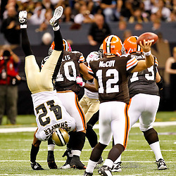 Oct 24, 2010; New Orleans, LA, USA; New Orleans Saints safety Darren Sharper (42) is upended by Cleveland Browns running back Peyton Hillis (40) as he blitzed the quarterback during the second half at the Louisiana Superdome. The Browns defeated the Saints 30-17.  Mandatory Credit: Derick E. Hingle