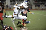 Paris Wildcats wide receiver Ja'kerion (cq) Brown (13) flies over Argyle defenders at Eagles Stadium in Argyle, Texas on September 26, 2015. (Robert W. Hart/Special Contributor)