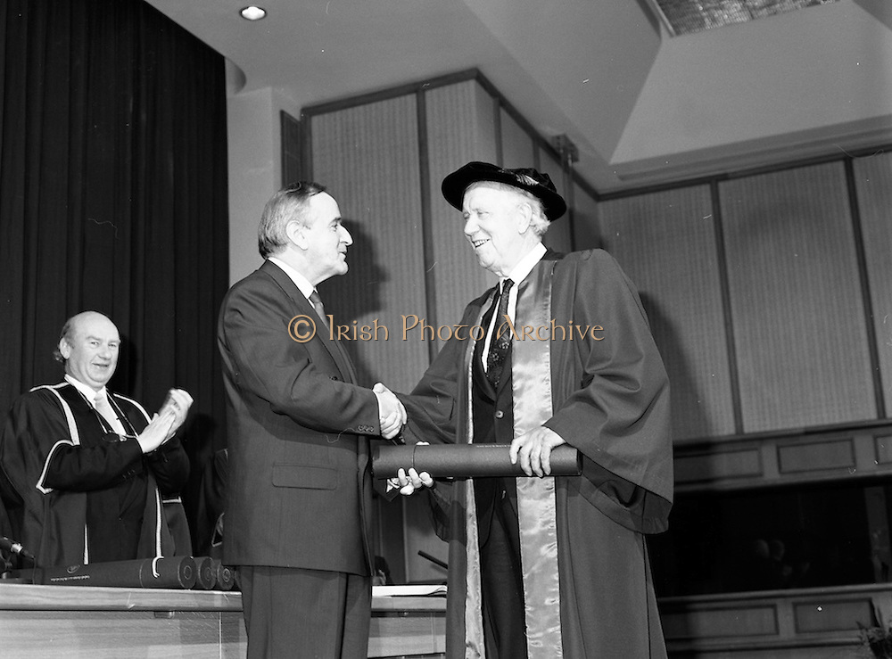 30/11/1992<br /> 11/30/1992<br /> 30 November 1992<br /> Conferring of Honorary Degrees (LL.D.) by the National Council for Educational Awards in Dublin Castle Conference Centre, Dublin. Picture shows Taoiseach Albert Reynolds, T.D. presenting Mr. Padraig Faulkner with his degree. A T.D. for many years, Mr. Faulkner was Minister for Education from 1969-73.