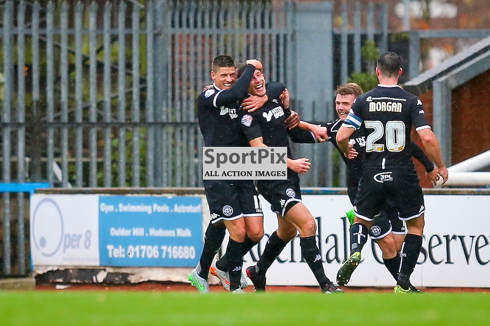 Jason Pearce is congratulated by his team mates for scoring the opening goal for Wigan Athletic during Rochdale v Wigan Athletic , Sky Bet League One Match, 14 November 2015<br /> Picture by Jackie Meredith/SportPix.org.uk