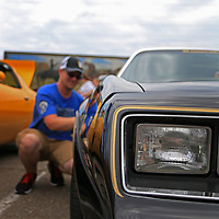 Bandit Run driver Matt McCammon polishes his Trans Am to get it ready for the viewing public at the Tupelo Automobile Museum.