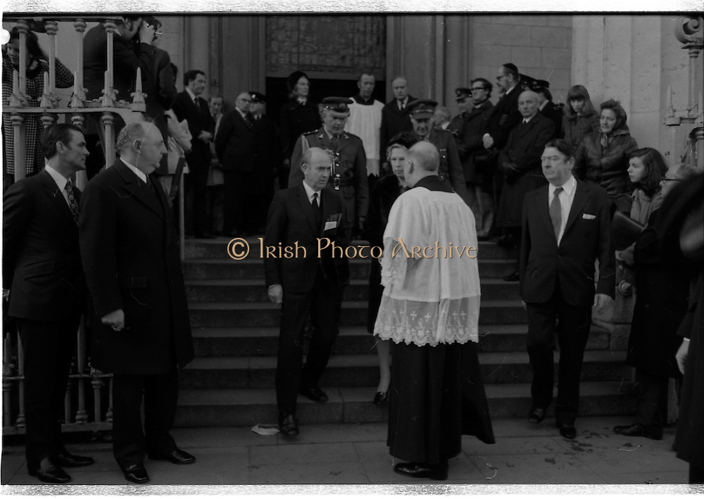 Funeral of Sinead Bean DeValera.    (H82)..1975..09.01.1975..01.09.1975..9th January 1975..Today saw the funeral of Sinead Bean DeValera take place at the Pro Cathedral, Dublin. She was the wife of Ex-President Eamon DeValera. Mrs Devalera was a noted author of childrens literature..Mrs DeValera, Born 3rd June 1878. Died 7th Jan 1975...Picture of President Cearbhall O'Dalaigh and his wife Mairin leaving the Pro-Cathedral after the requiem Mass for Sinead DeValera.